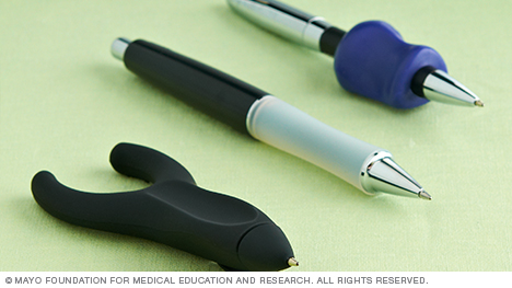 Photo showing a variety of pens designed to reduce stress on finger and thumb joints.