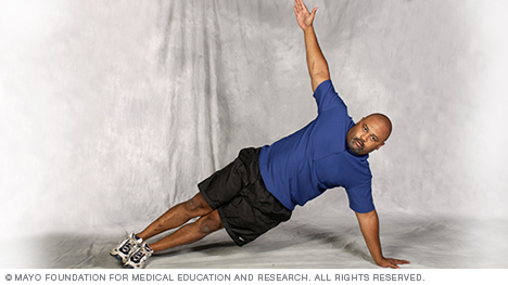 Photo of man doing core-strength exercises