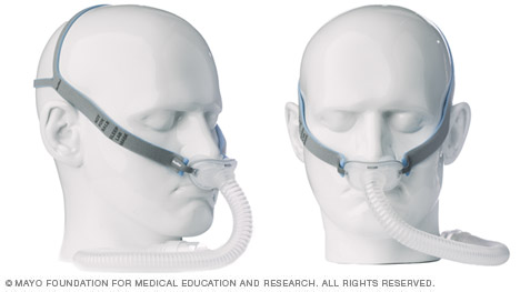 Photo of CPAP masks with nasal pillows and side straps