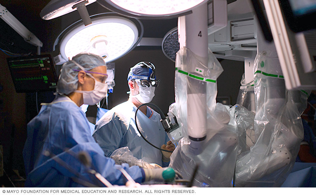 A surgical team assists at the operating table during robot-assisted heart surgery.